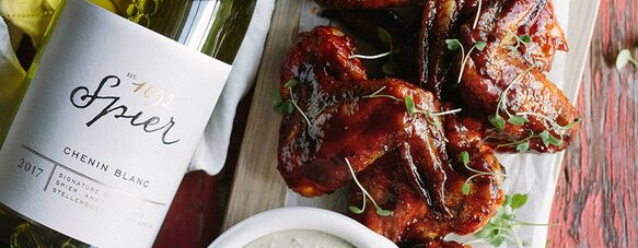 Sticky hot wings with blue cheese dip
